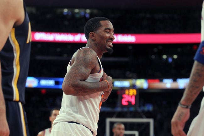 Nov 20, 2013; New York, NY, USA; New York Knicks shooting guard J.R. Smith (8) reacts against the Indiana Pacers during the third quarter at Madison Square Garden. The Pacers defeated the Knicks 103-96 in overtime. Mandatory Credit: Brad Penner-USA TODAY Sports