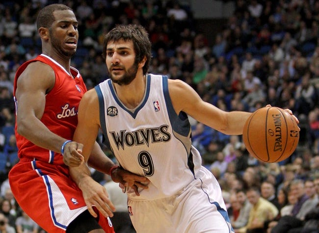 Nov 20, 2013; Minneapolis, MN, USA; Minnesota Timberwolves guard Ricky Rubio (9) dribbles past Los Angeles Clippers guard Chris Paul (3) during the third quarter at Target Center. The Clippers defeated the Timberwolves 102-98. Mandatory Credit: Brace Hemmelgarn-USA TODAY Sports