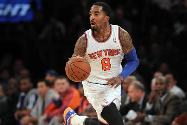 Nov 20, 2013; New York, NY, USA; New York Knicks shooting guard J.R. Smith (8) controls the ball against the Indiana Pacers during the second quarter at Madison Square Garden. The Pacers defeated the Knicks 103-96 in overtime. Mandatory Credit: Brad Penner-USA TODAY Sports