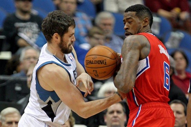 Nov 20, 2013; Minneapolis, MN, USA; Los Angeles Clippers center DeAndre Jordan (6) grabs the ball from Minnesota Timberwolves forward Kevin Love (42) during the first quarter at Target Center. The Clippers defeated the Timberwolves 102-98. Mandatory Credit: Brace Hemmelgarn-USA TODAY Sports