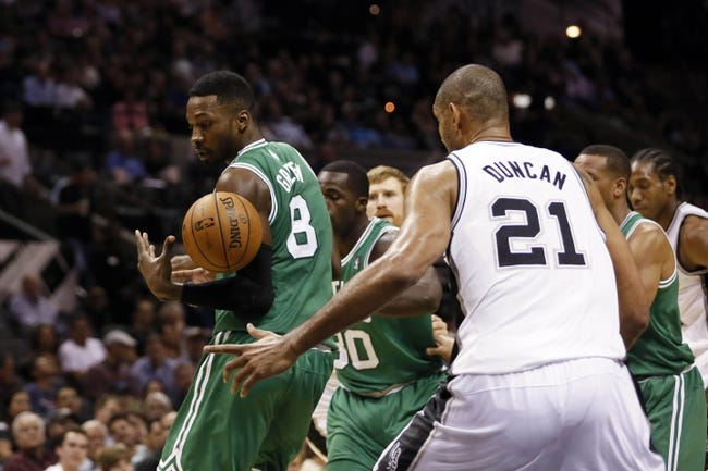 Nov 20, 2013; San Antonio, TX, USA; San Antonio Spurs forward Tim Duncan (21) attempts to steal the ball from Boston Celtics guard Jeff Green (8) during the second half at AT&T Center. The Spurs won 104-93. Mandatory Credit: Soobum Im-USA TODAY Sports