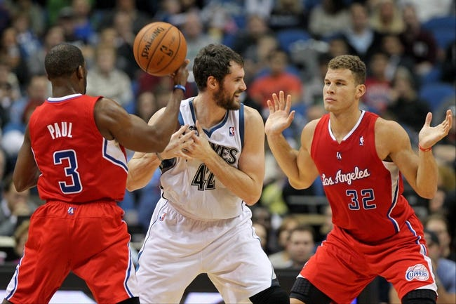 Nov 20, 2013; Minneapolis, MN, USA; Los Angeles Clippers guard Chris Paul (3) and forward Blake Griffin (32) guard Minnesota Timberwolves forward Kevin Love (42) during the second quarter at Target Center. The Clippers defeated the Timberwolves 102-98. Mandatory Credit: Brace Hemmelgarn-USA TODAY Sports