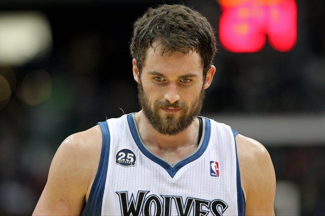 Nov 20, 2013; Minneapolis, MN, USA; Minnesota Timberwolves forward Kevin Love (42) looks down during the third quarter against the Los Angeles Clippers at Target Center. The Clippers defeated the Timberwolves 102-98. Mandatory Credit: Brace Hemmelgarn-USA TODAY Sports