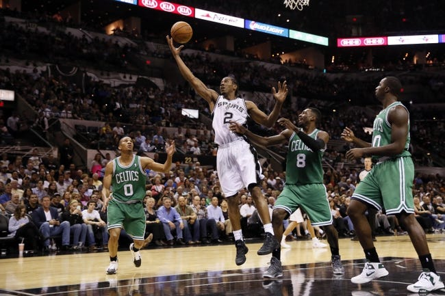 Nov 20, 2013; San Antonio, TX, USA; San Antonio Spurs forward Kawhi Leonard (2) reaches for a rebound with Boston Celtics guard Jeff Green (8) during the second half at AT&T Center. The Spurs won 104-93. Mandatory Credit: Soobum Im-USA TODAY Sports