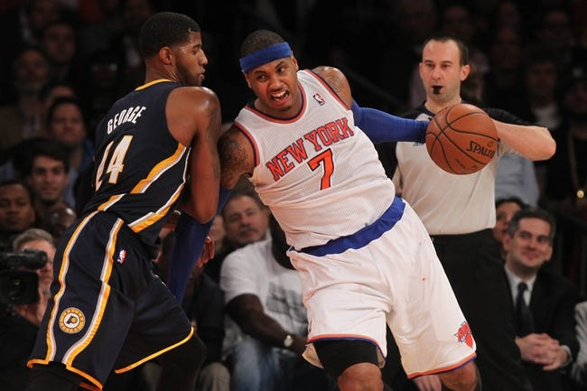 Nov 20, 2013; New York, NY, USA; New York Knicks small forward Carmelo Anthony (7) moves the ball against the defense of Indiana Pacers small forward Paul George (24) during the third quarter  at Madison Square Garden. The Pacers defeated the Knicks 103-96 in overtime. Mandatory Credit: Brad Penner-USA TODAY Sports