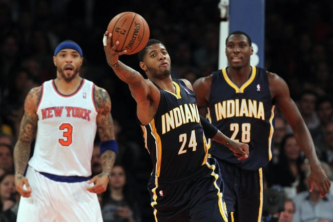 Nov 20, 2013; New York, NY, USA; Indiana Pacers small forward Paul George (24) grabs a rebound in front of New York Knicks power forward Kenyon Martin (3) during the third quarter at Madison Square Garden. The Pacers defeated the Knicks 103-96 in overtime. Mandatory Credit: Brad Penner-USA TODAY Sports