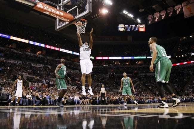 Nov 20, 2013; San Antonio, TX, USA; San Antonio Spurs forward Boris Diaw (33) shoots as Boston Celtics guard Jeff Green (8), and Avery Bradley (0), and Courtney Lee (11) look on during the second half at AT&T Center. The Spurs won 104-93. Mandatory Credit: Soobum Im-USA TODAY Sports