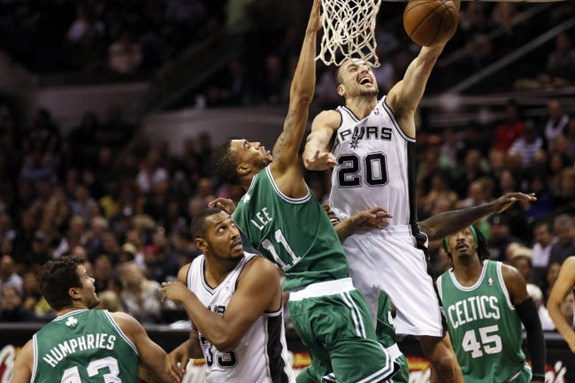 Nov 20, 2013; San Antonio, TX, USA; San Antonio Spurs guard Manu Ginobili (20) drives to the basket under pressure from Boston Celtics guard Courtney Lee (11) during the second half at AT&T Center. The Spurs won 104-93. Mandatory Credit: Soobum Im-USA TODAY Sports