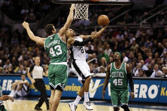 Nov 20, 2013; San Antonio, TX, USA; San Antonio Spurs guard Patrick Mills (8) drives to the basket under pressure from Boston Celtics forward Kris Humphries (43) during the second half at AT&T Center. The Spurs won 104-93. Mandatory Credit: Soobum Im-USA TODAY Sports