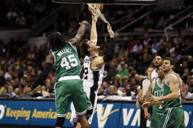 Nov 20, 2013; San Antonio, TX, USA; San Antonio Spurs forward Tiago Splitter (22) drives to the basket as Boston Celtics forward Gerald Wallace (45) defends during the second half at AT&T Center. The Spurs won 104-93. Mandatory Credit: Soobum Im-USA TODAY Sports