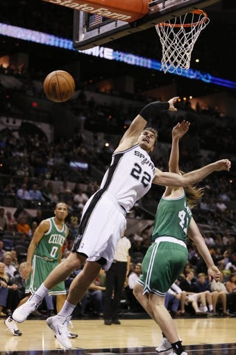 Nov 20, 2013; San Antonio, TX, USA; San Antonio Spurs forward Tiago Splitter (22) gets fouled while shooting against Boston Celtics center Kelly Olynyk (41) during the second half at AT&T Center. The Spurs won 104-93. Mandatory Credit: Soobum Im-USA TODAY Sports