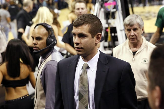 Nov 20, 2013; San Antonio, TX, USA; Boston Celtics head coach Brad Stevens leaves the court following a 104-83 loss to the San Antonio Spurs at AT&T Center. The Spurs won 104-93. Mandatory Credit: Soobum Im-USA TODAY Sports