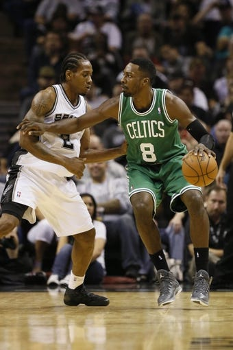 Nov 20, 2013; San Antonio, TX, USA; Boston Celtics guard Jeff Green (8) is defended by San Antonio Spurs forward Kawhi Leonard (left) during the second half at AT&T Center. The Spurs won 104-93. Mandatory Credit: Soobum Im-USA TODAY Sports
