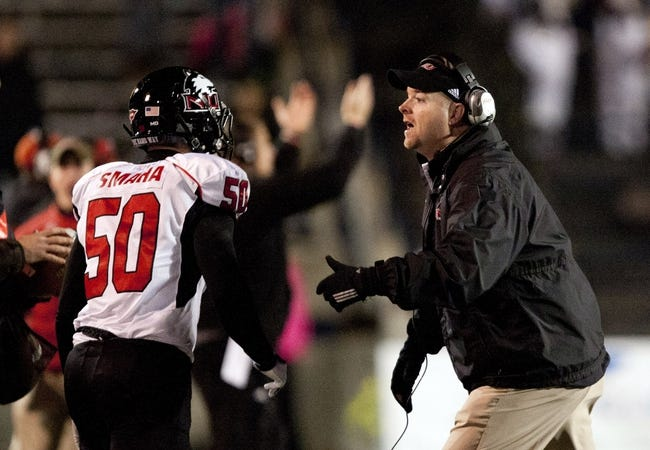 Nov 20, 2013; Toledo, OH, USA; Northern Illinois Huskies head coach Rod Carey and defensive end Austin Smaha (50) during the fourth quarter against the Toledo Rockets at Glass Bowl. The Huskies beat the Rockets 35-17. Mandatory Credit: Raj Mehta-USA TODAY Sports