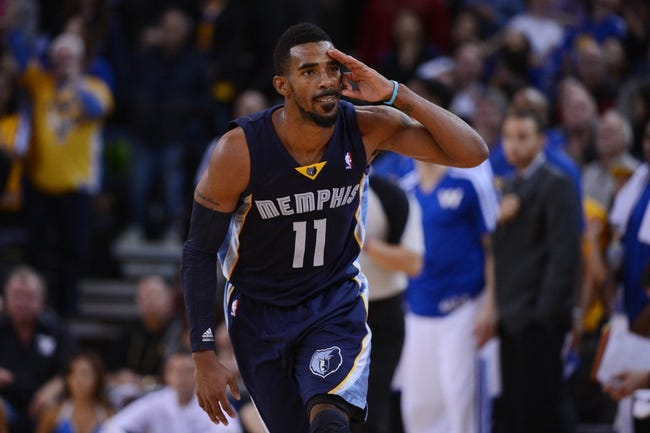 November 20, 2013; Oakland, CA, USA; Memphis Grizzlies point guard Mike Conley (11) celebrates after making a basket against the Golden State Warriors during overtime at Oracle Arena. The Grizzlies defeated the Warriors 88-81 in overtime. Mandatory Credit: Kyle Terada-USA TODAY Sports