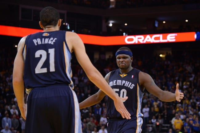 November 20, 2013; Oakland, CA, USA; Memphis Grizzlies power forward Zach Randolph (50) celebrates with small forward Tayshaun Prince (21) against the Golden State Warriors during overtime at Oracle Arena. The Grizzlies defeated the Warriors 88-81 in overtime. Mandatory Credit: Kyle Terada-USA TODAY Sports