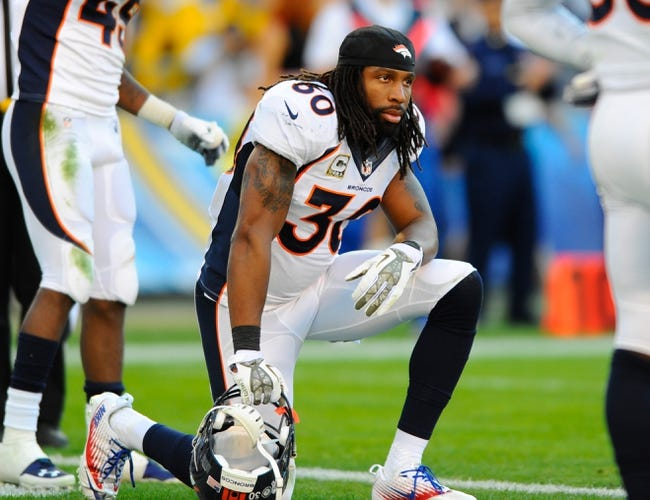 Nov 10, 2013; San Diego, CA, USA; Denver Broncos safety David Bruton (30) during the second half against the San Diego Chargers at Qualcomm Stadium. The Broncos won 28-20. Mandatory Credit: Christopher Hanewinckel-USA TODAY Sports