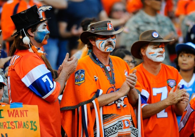 Nov 10, 2013; San Diego, CA, USA; Denver Broncos fans look on during the second half against the San Diego Chargers at Qualcomm Stadium. The Broncos won 28-20. Mandatory Credit: Christopher Hanewinckel-USA TODAY Sports