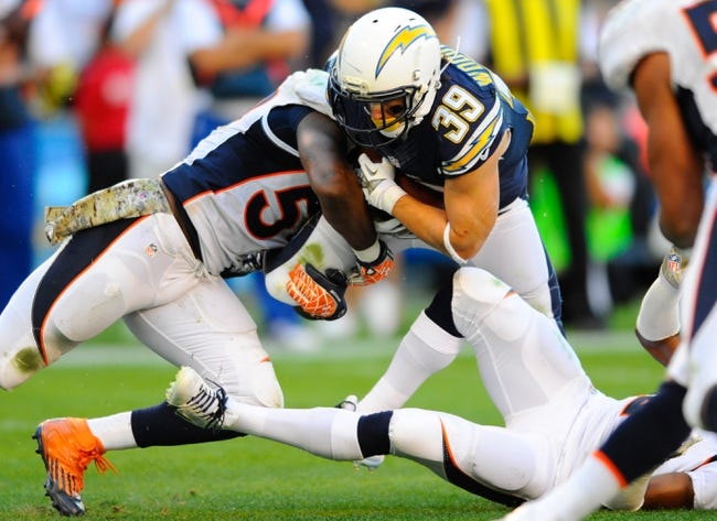 Nov 10, 2013; San Diego, CA, USA; San Diego Chargers running back Danny Woodhead (39) is tackled by Denver Broncos linebacker Danny Trevathan (59) during the second half at Qualcomm Stadium. The Broncos won 28-20. Mandatory Credit: Christopher Hanewinckel-USA TODAY Sports
