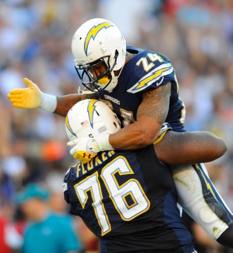 Nov 10, 2013; San Diego, CA, USA; San Diego Chargers running back Ryan Mathews (24) celebrates with offensive tackle D.J. Fluker (76) after a touchdown run during the second half against the Denver Broncos at Qualcomm Stadium. The Broncos won 28-20. Mandatory Credit: Christopher Hanewinckel-USA TODAY Sports