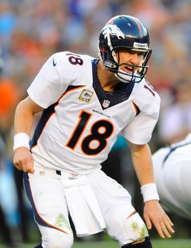 Nov 10, 2013; San Diego, CA, USA; Denver Broncos quarterback Peyton Manning (18) calls plays at the line during the second half against the San Diego Chargers at Qualcomm Stadium. The Broncos won 28-20. Mandatory Credit: Christopher Hanewinckel-USA TODAY Sports