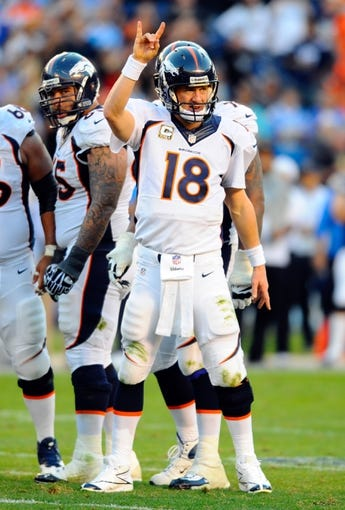 Nov 10, 2013; San Diego, CA, USA; Denver Broncos quarterback Peyton Manning (18) looks to the sideline during the second half against the San Diego Chargers at Qualcomm Stadium. The Broncos won 28-20. Mandatory Credit: Christopher Hanewinckel-USA TODAY Sports
