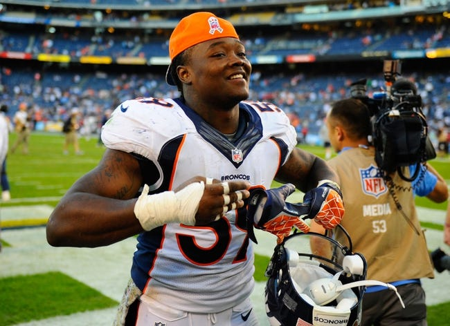 Nov 10, 2013; San Diego, CA, USA; Denver Broncos linebacker Danny Trevathan (59) after a win against the San Diego Chargers at Qualcomm Stadium. The Broncos won 28-20. Mandatory Credit: Christopher Hanewinckel-USA TODAY Sports