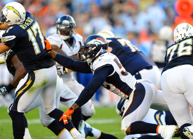 Nov 10, 2013; San Diego, CA, USA; Denver Broncos linebacker Von Miller (58) recaches for San Diego Chargers quarterback Philip Rivers (17) as he throws the ball during the second half at Qualcomm Stadium. The Broncos won 28-20. Mandatory Credit: Christopher Hanewinckel-USA TODAY Sports