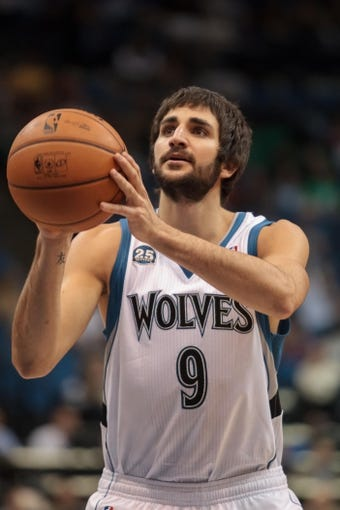 Nov 13, 2013; Minneapolis, MN, USA; Minnesota Timberwolves point guard Ricky Rubio (9) shoots in the third quarter against the Cleveland Cavaliers at Target Center. The Minnesota Timberwolves win 124-95. Mandatory Credit: Brad Rempel-USA TODAY Sports.
