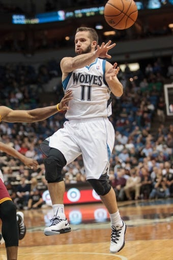 Nov 13, 2013; Minneapolis, MN, USA; Minnesota Timberwolves point guard J.J. Barea (11) passes in the fourth quarter against the Cleveland Cavaliers at Target Center. The Minnesota Timberwolves win 124-95. Mandatory Credit: Brad Rempel-USA TODAY Sports.