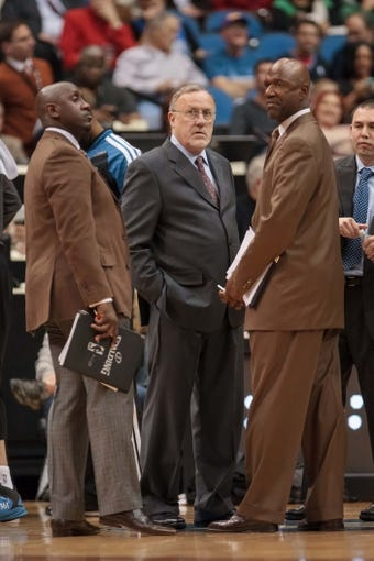 Nov 13, 2013; Minneapolis, MN, USA; Minnesota Timberwolves coaches Bobby Jackson and Rick Adelman and Terry Porter in the third quarter against the Cleveland Cavaliers at Target Center. The Minnesota Timberwolves win 124-95. Mandatory Credit: Brad Rempel-USA TODAY Sports.