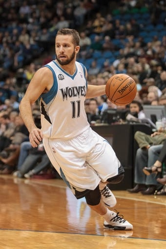 Nov 13, 2013; Minneapolis, MN, USA; Minnesota Timberwolves point guard J.J. Barea (11) dribbles in the fourth quarter against the Cleveland Cavaliers at Target Center. The Minnesota Timberwolves win 124-95. Mandatory Credit: Brad Rempel-USA TODAY Sports.
