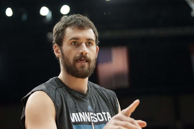 Nov 13, 2013; Minneapolis, MN, USA; Minnesota Timberwolves power forward Kevin Love (42) warms up before the game against the Cleveland Cavaliers at Target Center. The Minnesota Timberwolves win 124-95. Mandatory Credit: Brad Rempel-USA TODAY Sports.