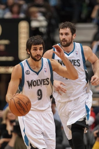 Nov 13, 2013; Minneapolis, MN, USA; Minnesota Timberwolves point guard Ricky Rubio (9) signals a play with power forward Kevin Love (42) in the third quarter against the Cleveland Cavaliers at Target Center. The Minnesota Timberwolves win 124-95. Mandatory Credit: Brad Rempel-USA TODAY Sports.