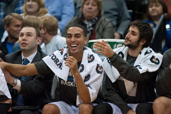 Nov 1, 2013; Minneapolis, MN, USA; Minnesota Timberwolves shooting guard Kevin Martin (23) and point guard Ricky Rubio (9) during the fourth quarter against the Oklahoma City Thunder at Target Center. Timberwolves won 100-81. Mandatory Credit: Greg Smith-USA TODAY Sports
