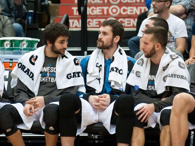 Nov 1, 2013; Minneapolis, MN, USA; (l. to r.) Minnesota Timberwolves point guard Ricky Rubio (9), power forward Kevin Love (42) and point guard J.J. Barea (11) during the final minutes of the fourth quarter against the Oklahoma City Thunder at Target Center. Timberwolves won 100-81. Mandatory Credit: Greg Smith-USA TODAY Sports