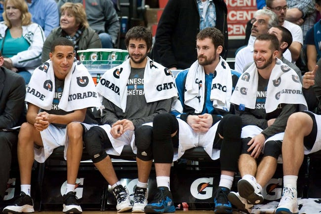Nov 1, 2013; Minneapolis, MN, USA; (l. to r.) Minnesota Timberwolves shooting guard Kevin Martin (23), point guard Ricky Rubio (9), power forward Kevin Love (42) and point guard J.J. Barea (11) during the final minutes of the fourth quarter against the Oklahoma City Thunder at Target Center. Timberwolves won 100-81. Mandatory Credit: Greg Smith-USA TODAY Sports