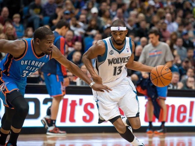 Nov 1, 2013; Minneapolis, MN, USA; Minnesota Timberwolves small forward Corey Brewer (13) dribbles against Oklahoma City Thunder small forward Kevin Durant (35) in the second quarter at Target Center. Timberwolves won 100-81. Mandatory Credit: Greg Smith-USA TODAY Sports