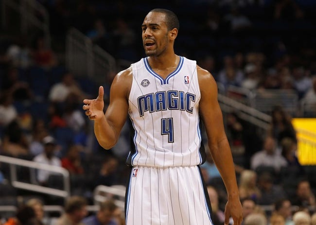Oct 18, 2013; Orlando, FL, USA; Orlando Magic shooting guard Arron Afflalo (4) against the Memphis Grizzlies during the first half at Amway Center. Mandatory Credit: Kim Klement-USA TODAY Sports