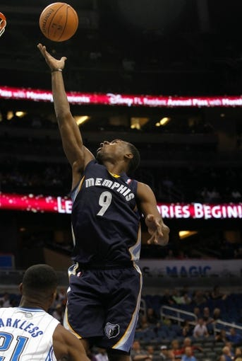 Oct 18, 2013; Orlando, FL, USA; Memphis Grizzlies shooting guard Tony Allen (9) shoots against the Orlando Magic during the first half at Amway Center. Mandatory Credit: Kim Klement-USA TODAY Sports