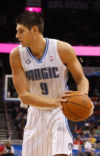 Oct 18, 2013; Orlando, FL, USA; Orlando Magic center Nikola Vucevic (9) against the Memphis Grizzlies during the second half at Amway Center. Memphis Grizzlies defeated the Orlando Magic 97-91. Mandatory Credit: Kim Klement-USA TODAY Sports