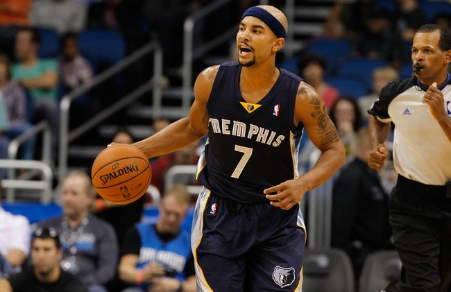 Oct 18, 2013; Orlando, FL, USA;Memphis Grizzlies point guard Jerryd Bayless (7)  dribbles the ball  against the Orlando Magic  during the first half at Amway Center. Mandatory Credit: Kim Klement-USA TODAY Sports