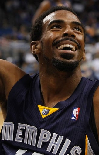 Oct 18, 2013; Orlando, FL, USA; Memphis Grizzlies point guard Mike Conley (11) against the Orlando Magic during the first half at Amway Center. Mandatory Credit: Kim Klement-USA TODAY Sports