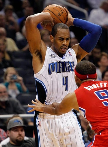 Nov 6, 2013; Orlando, FL, USA; Orlando Magic shooting guard Arron Afflalo (4) drives to the basket as Los Angeles Clippers small forward Jared Dudley (9) defends during the second half at Amway Center. Orlando Magic defeated the Los Angeles Clippers 98-90. Mandatory Credit: Kim Klement-USA TODAY Sports
