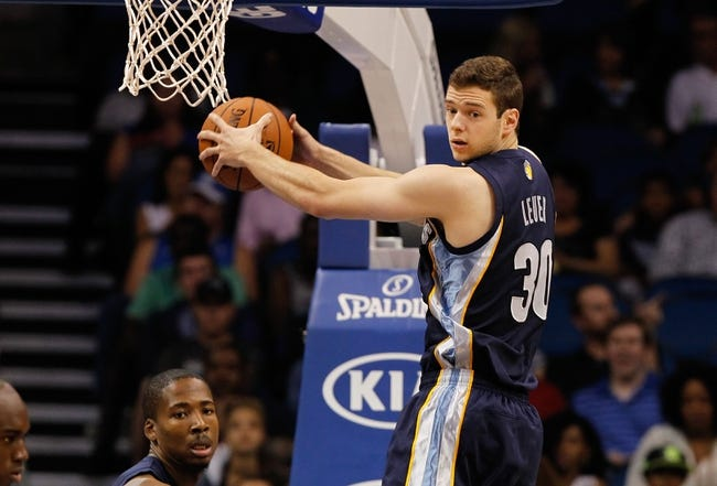 Oct 18, 2013; Orlando, FL, USA; Memphis Grizzlies power forward Jon Leuer (30) grabs a rebound against the Orlando Magic during the first half at Amway Center. Mandatory Credit: Kim Klement-USA TODAY Sports