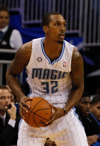 Oct 18, 2013; Orlando, FL, USA; Orlando Magic small forward Kris Joseph (32) against the Memphis Grizzlies during the first half at Amway Center. Mandatory Credit: Kim Klement-USA TODAY Sports