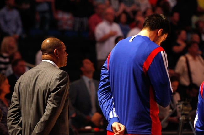 Nov 6, 2013; Orlando, FL, USA; Los Angeles Clippers head coach Doc Rivers listens during the national anthem against the Orlando Magic at Amway Center. Mandatory Credit: Kim Klement-USA TODAY Sports