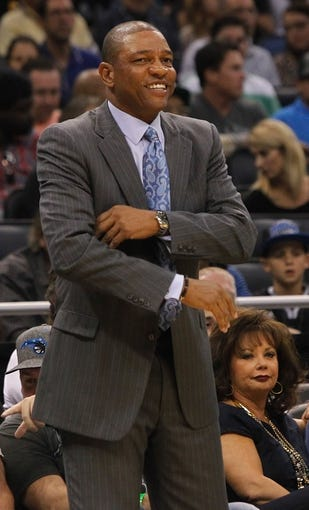 Nov 6, 2013; Orlando, FL, USA; Los Angeles Clippers head coach Doc Rivers smiles against the Orlando Magic during the first quarter at Amway Center. Mandatory Credit: Kim Klement-USA TODAY Sports