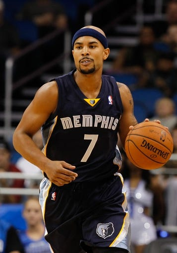 Oct 18, 2013; Orlando, FL, USA; Memphis Grizzlies point guard Jerryd Bayless (7) dribbles the ball against the Orlando Magic during the first half at Amway Center. Mandatory Credit: Kim Klement-USA TODAY Sports
