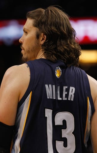 Oct 18, 2013; Orlando, FL, USA; Memphis Grizzlies small forward Mike Miller (13) against the Orlando Magic during the first half at Amway Center. Mandatory Credit: Kim Klement-USA TODAY Sports